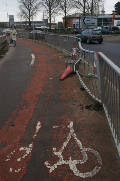 Photo of damaged cycle lane and barrier that car has crashed in to