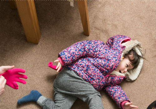 Child having tantrum on floor