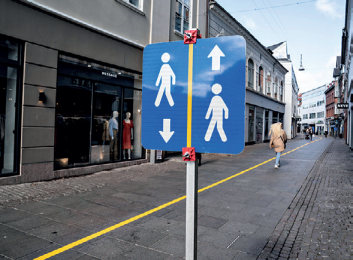 Figure 16: A yellow stripe painted in the middle of a pedestrian street to help people comply with social distance guidelines – Aalborg, Denmark, (Copyright Henning Bagger/Ritzau Scanpix/via REUTERS edited)
