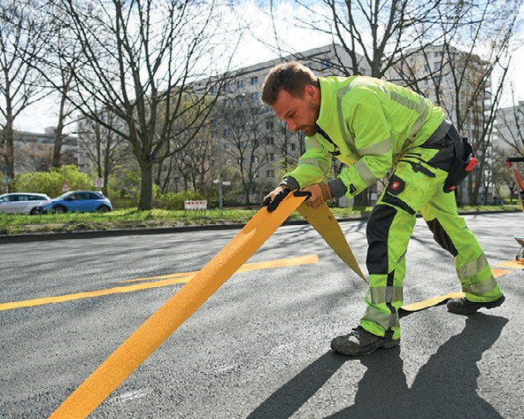 Figure 28: Pop up cycle lanes being installed. – Berlin (Copyright, Reuters images)