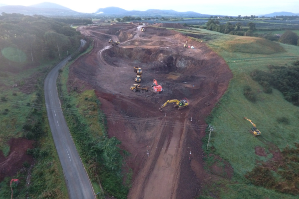 Photo from above of digging machines excavating the earth shaping the A487 bypass.