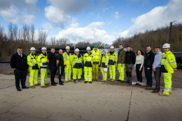 Ken Skates, Minister for North Wales with contractors and apprentices at the A487 bypass development.