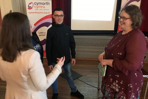 A member of the Commission on Justice in Wales, Dr Nerys Llewelyn Jones with director of Cymorth Cymru, Katie Dalton at the event in Rhyl Town Hall.